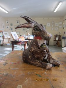 Photo of a ceramic hare telling time